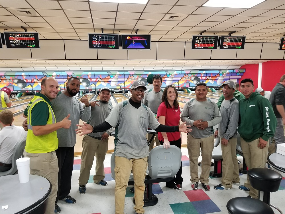 Greenscape landscaping team having fun at bowling party