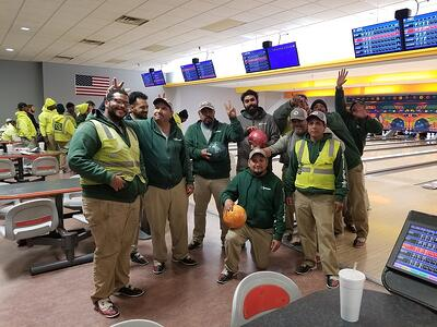 Greenscape landscaping employees enjoying company bowling party