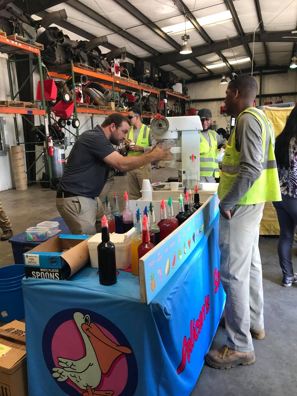 Greenscape team getting snow cones at branch