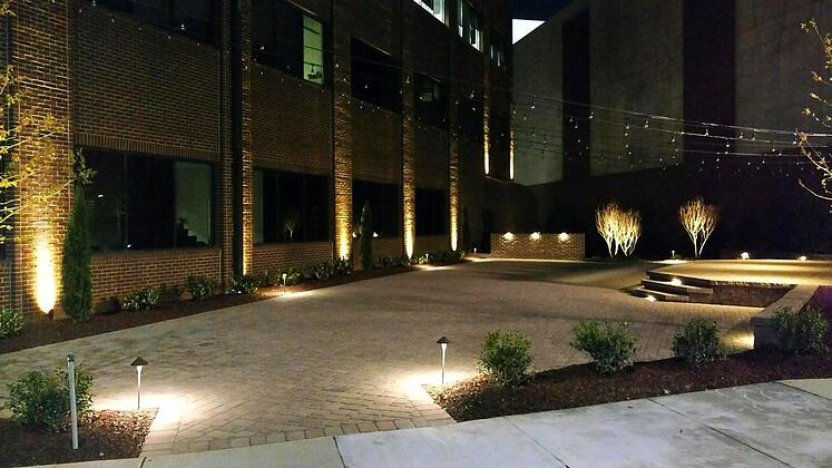 landscape lighting makes a huge difference on this patio