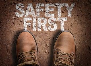 Safety first written on dirt