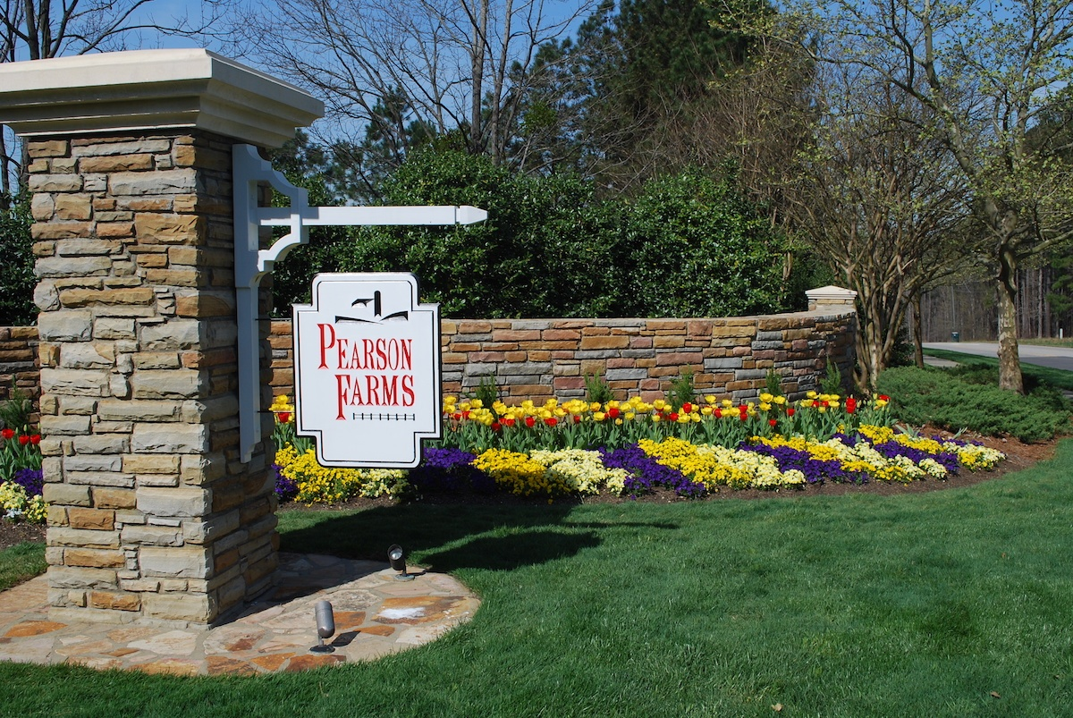 Commercial landscape sign with flowers & stone